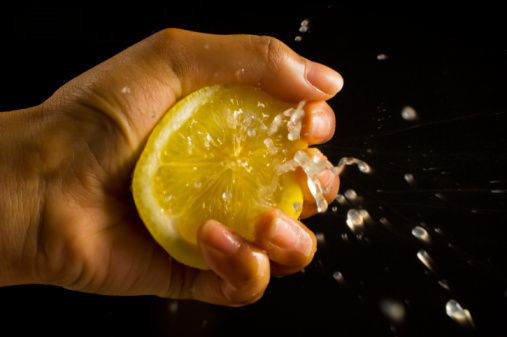 lemon-being-squeezed